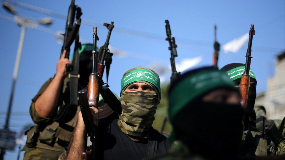 File photo - Hamas militants hold weapons as they celebrate the release of Palestinian prisoner Mohammed al-Bashiti, in Rafah, July 2016.