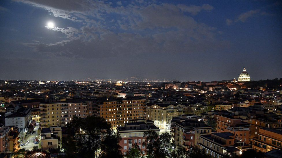 The spectacular Super Pink Moon rises above Rome, Italy