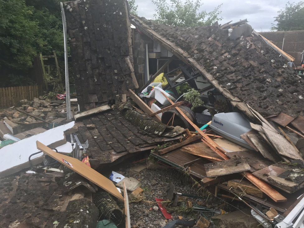 Debris left by a collapsed outdoor building