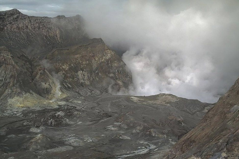 A video screenshot of the volcano spewing steam and ash