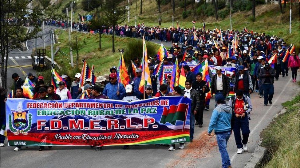 Supporters of Evo Morales march during a protest from El Alto to La Paz on November 13, 2019