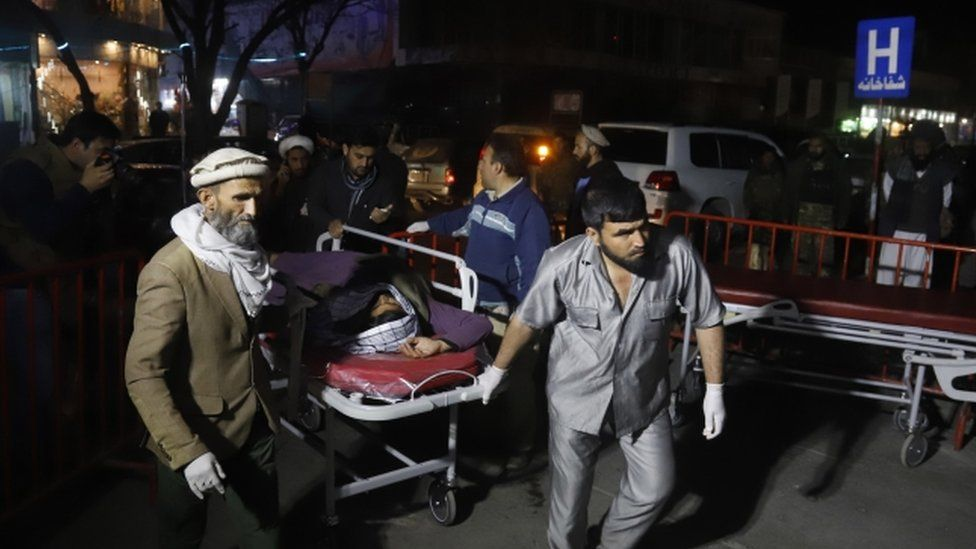 An injured person is taken to hospital in Kabul