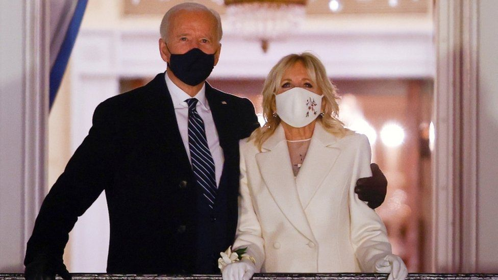 President Joe Biden and first lady Jill Biden watch fireworks from the White House