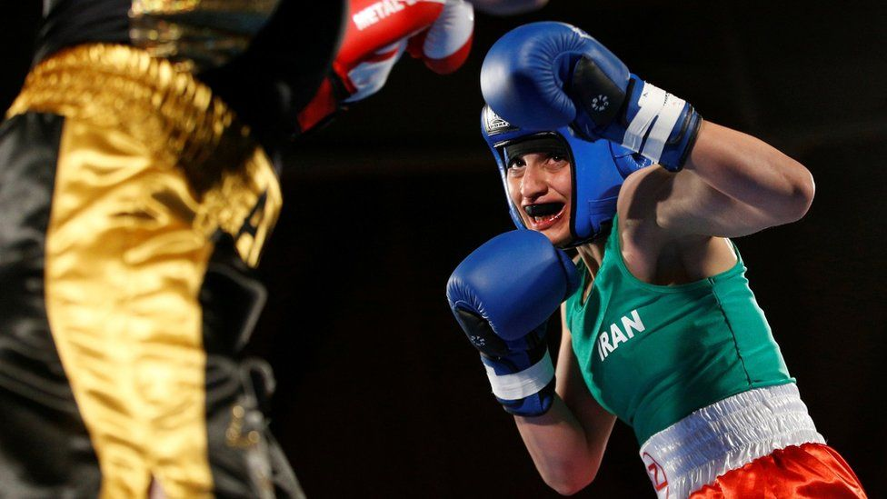 Iranian boxer Sadaf Khadem (R) beats the French boxer Anne Chauvin (L) in an amateur bout on 13 April 2019