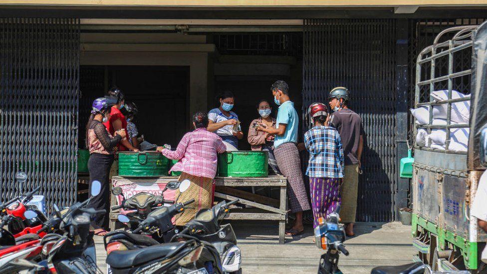 People buying food in Yangon