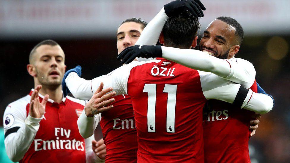 Arsenal players celebrate a goal