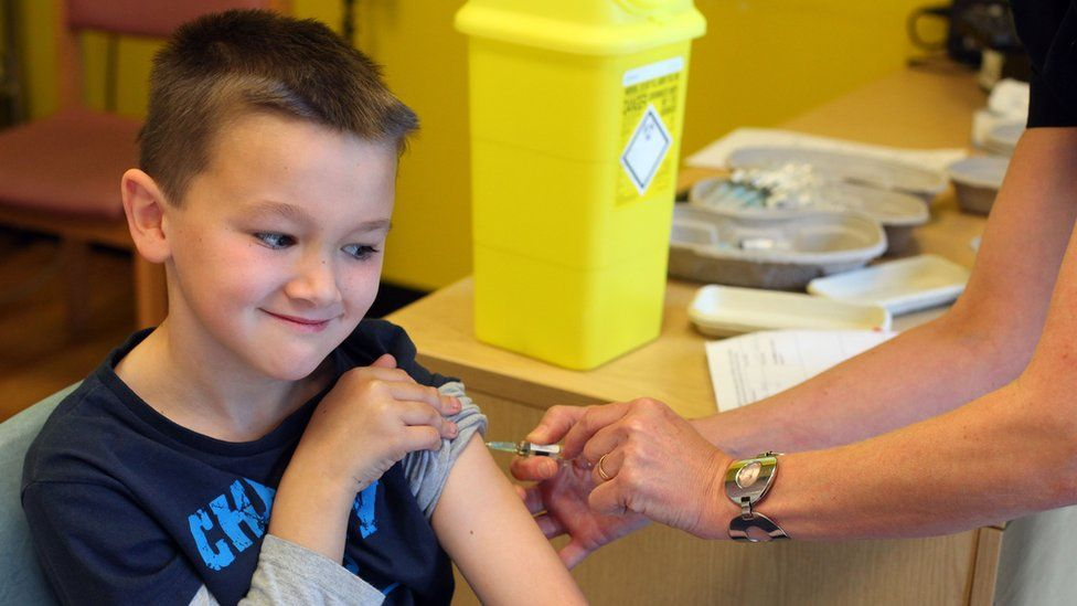 boy being vaccinated