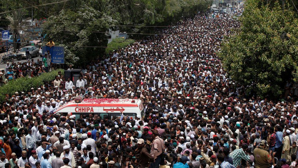 Thousands of people attend the funeral procession of Amjad Sabri