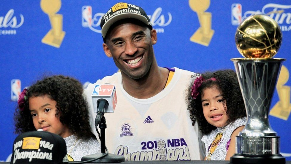 Kobe Bryant with daughters Gianna and Natalia after winning the 2010 NBA Finals basketball series in Los Angeles, California, in 2010