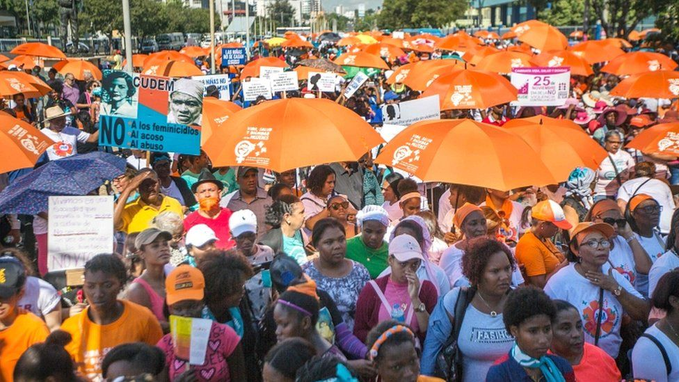 Demonstrators take part in a march to demand the decriminalisation of abortion on the International Day for the Elimination of Violence against Women in Santo Domingo