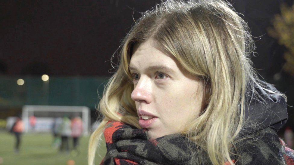 Arina watching Nina play football