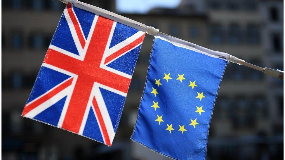 A UK flag appears next to a European Union flag