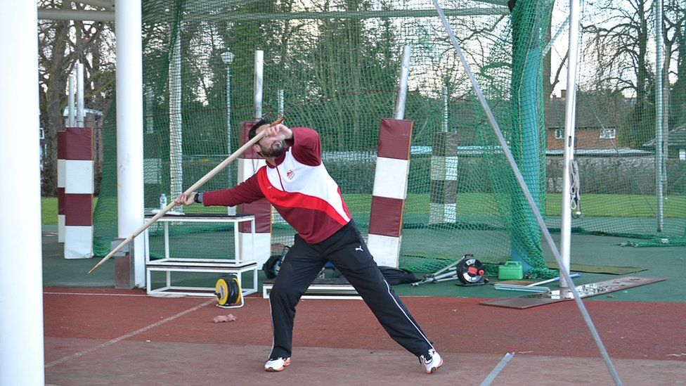 Athlete throwing spear
