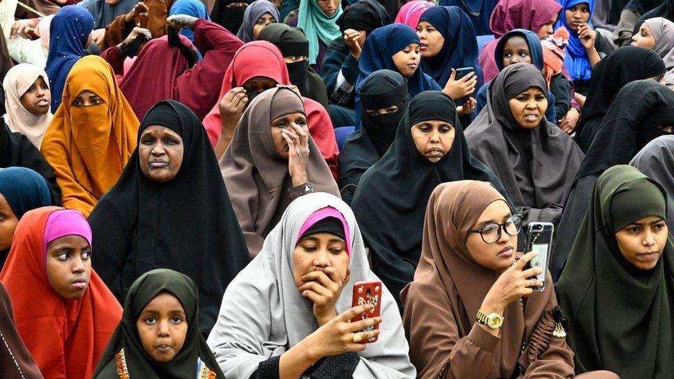 Women in Nairobi listening to an imam