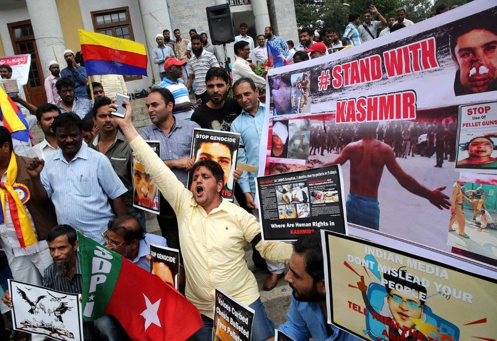 Kashmiri Muslims hold placards and shout slogans as they protest against the civilian killings in Kashmir's ongoing summer unrest, in Bangalore, India on 08 August 2016.