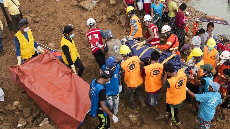 Families of victims join a search and rescue operation following a landslide in Kachin in July 2018