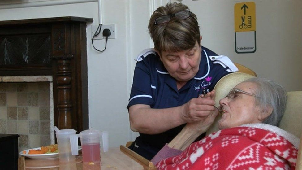 Sue Gregory caring for a resident at her care home