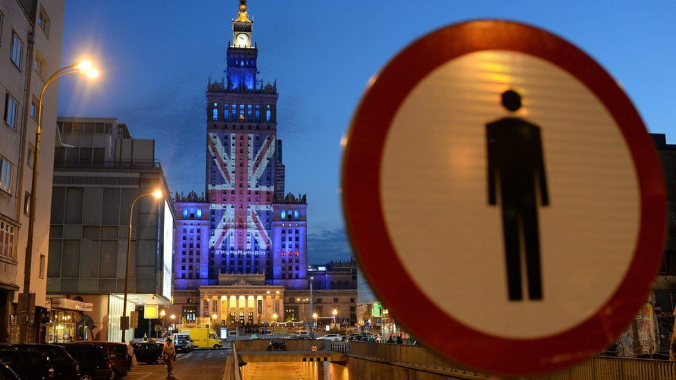 The British flag is displayed on the facade of the Palace of Culture and Science in Warsaw, Poland, 22 June 2016