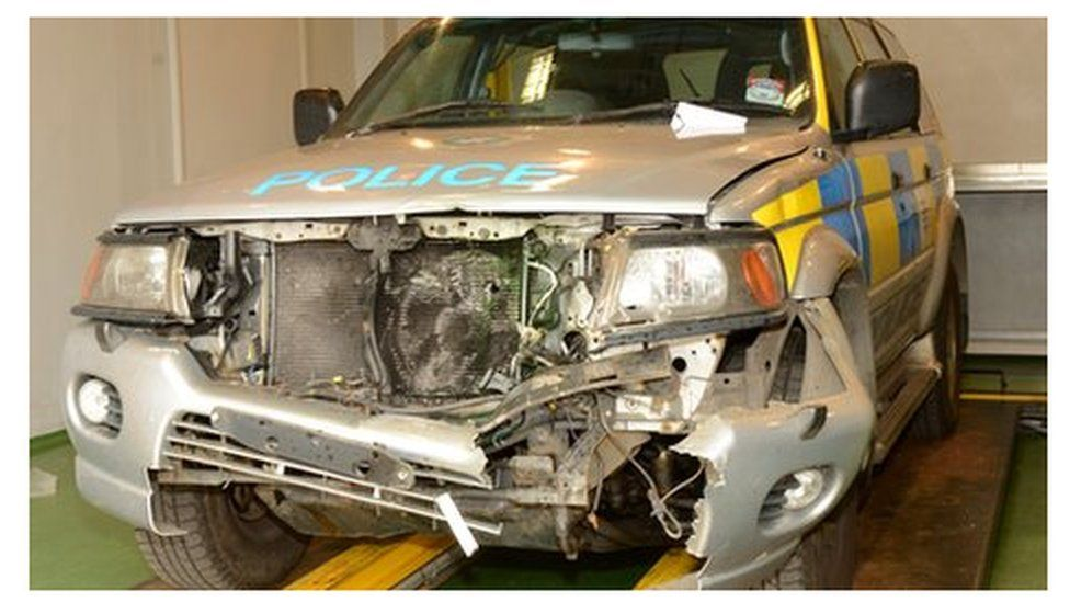 The front of the police vehicle was badly damaged in the incident