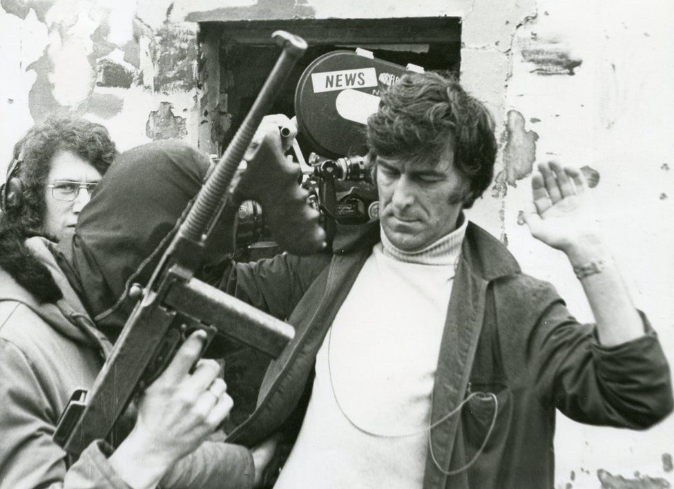 Cyril Cave and Jim Deeney filming an IRA gunman in the Bogside in Derry