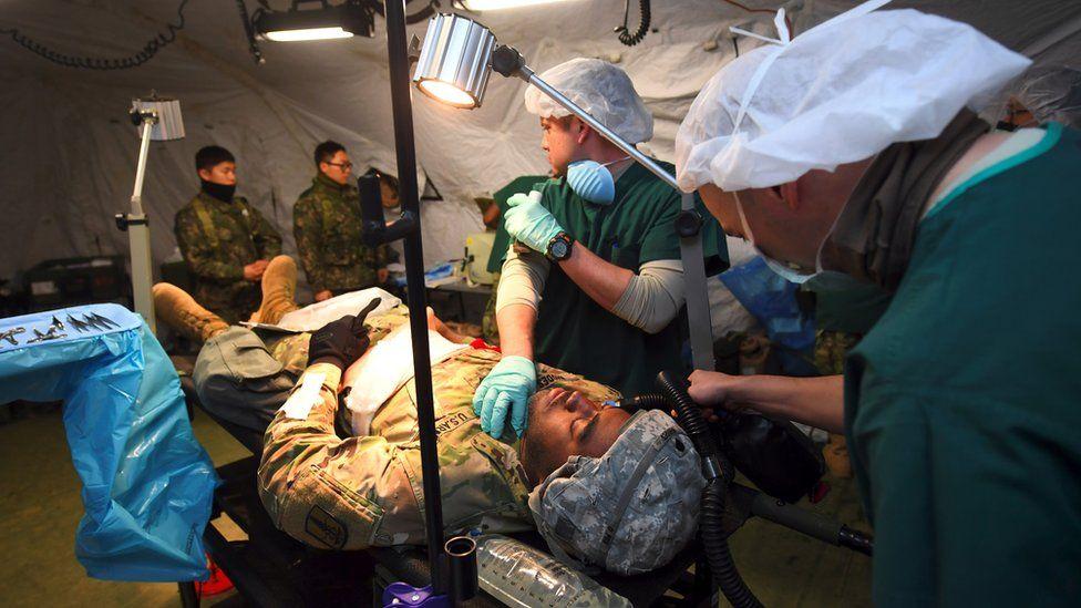 Medics treat a mock victim during US-SK drills (March 2017)