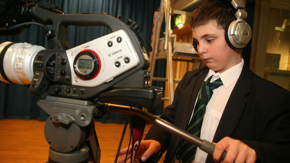 Boy using camera