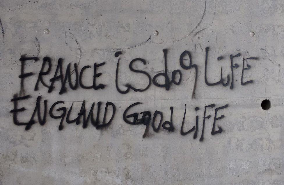 "Graffiti reading: ""France is dog life (sic), England good life"""