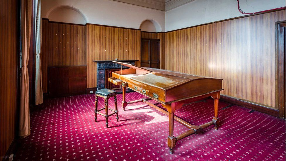 Thomas Andrew's office is shown restored