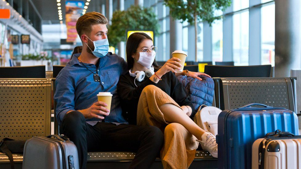 Couple waiting at airport (stock image)