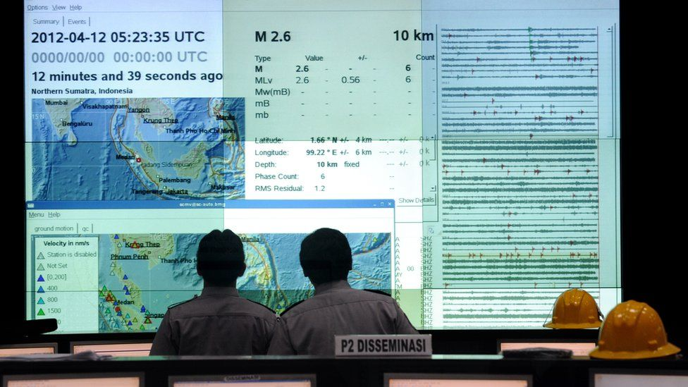 Indonesian Meteorology and Geophysics Agency (BMKG) staff monitor the latest seismic activities in the area of Sumatra island from their Jakarta headquarters on April 12, 2012 the day after an 8.6-magnitude quake hit 431 kilometres (268 miles) off the city of Banda Aceh