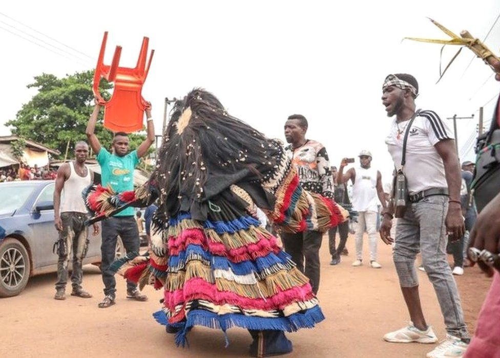 A man in a masquerade costume performing in the streets of Arondizuogu during the Ikeji Festival in Nigeria