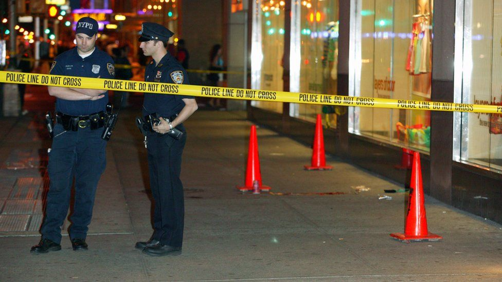Picture showing New York Policemen outside a crime scene