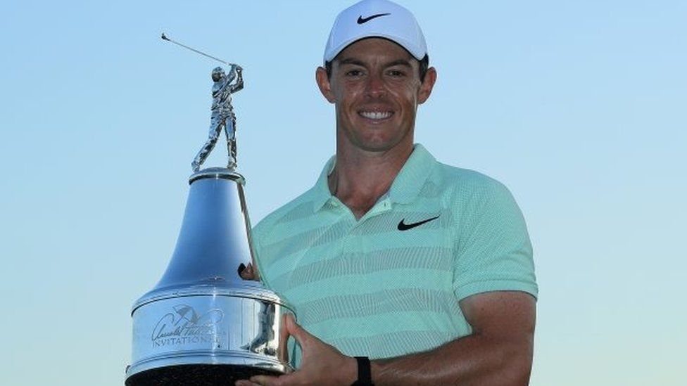 Rory McIlroy holding the trophy at the Arnold Palmer Invitational