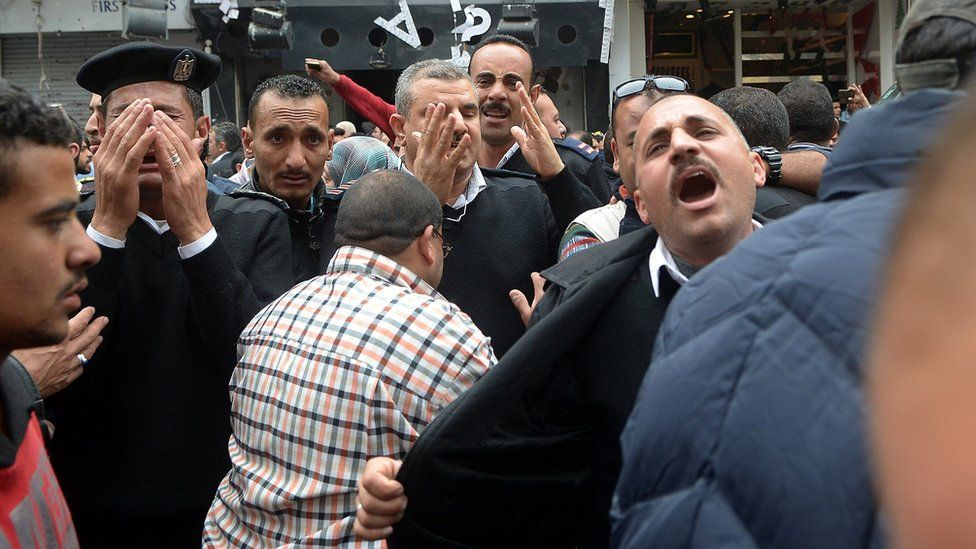 """A group of Egyptian police personnel mourn outside the Saint Mark""""s coptic Cathedral in Alexandria, 250km northwest of Cairo, Egypt, 09 April 2017"""
