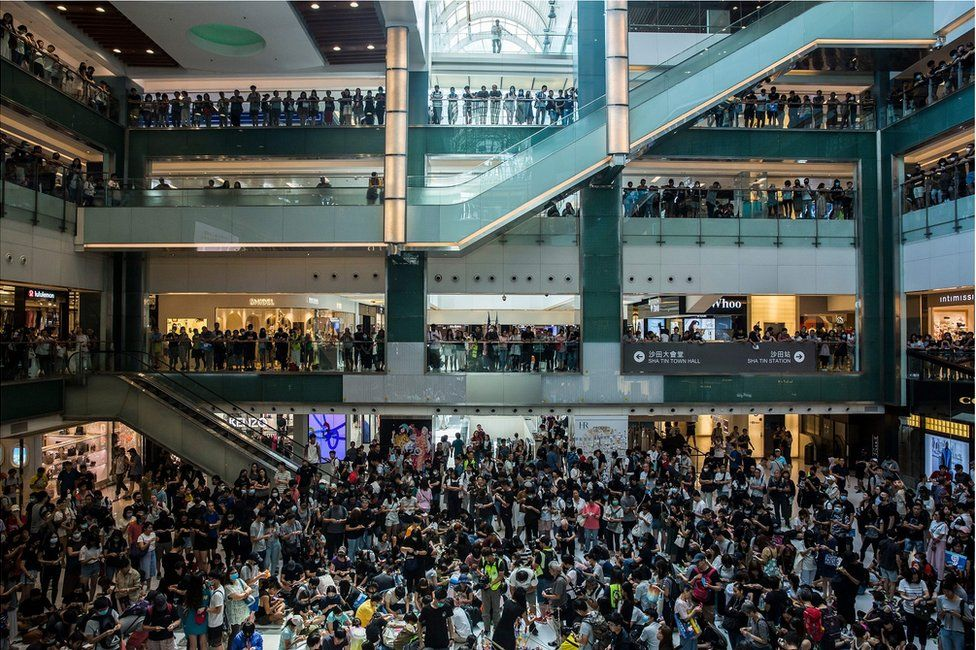People gather at an anti-government rally inside a shopping mall at the Sha Tin district of Hong Kong on 22 September 2019