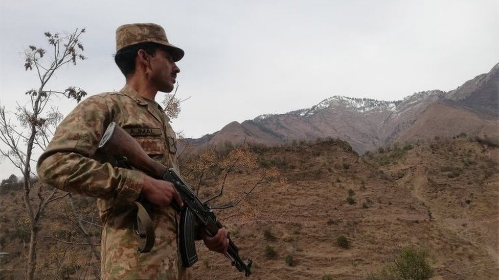 File photo of Pakistani Army soldier standing guard at the Line of Control, the de facto border between Pakistani and Indian administered Kashmir in Chakothi, Azad Kashmir, Pakistan, 23 February 2019.