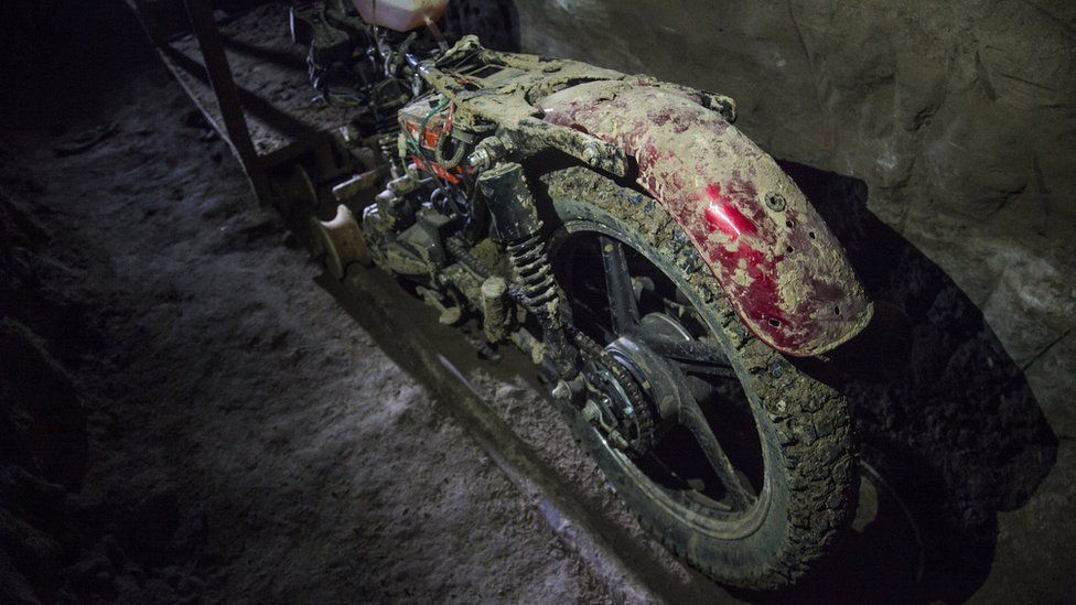 """View of a motorcycle adapted to a rail used by Mexican drug trafficker Joaquin """"El Chapo"""" Guzman to move through a tunnel"""