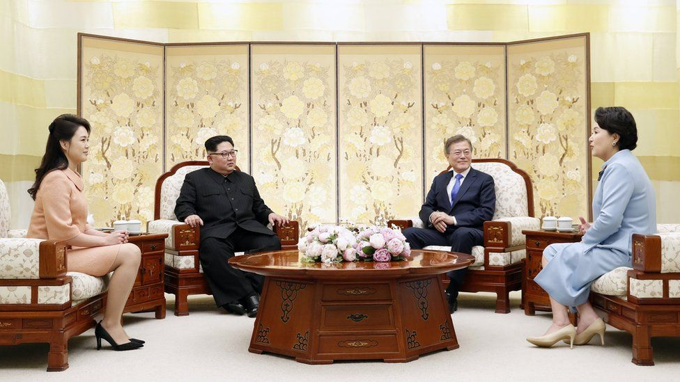 Moon Jae-in (2-R) and his wife Kim Jung-sook (R) chat with North Korean leader Kim Jong-un (2-L) and his wife, Ri Sol-ju (L)
