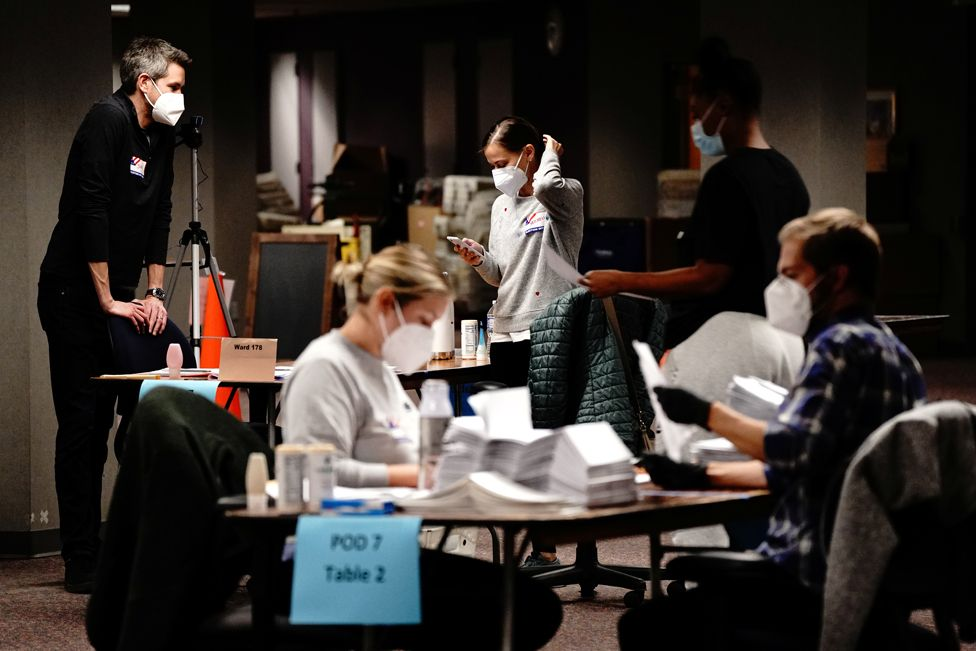 Workers process absentee ballots in Milwaukee, Wisconsin