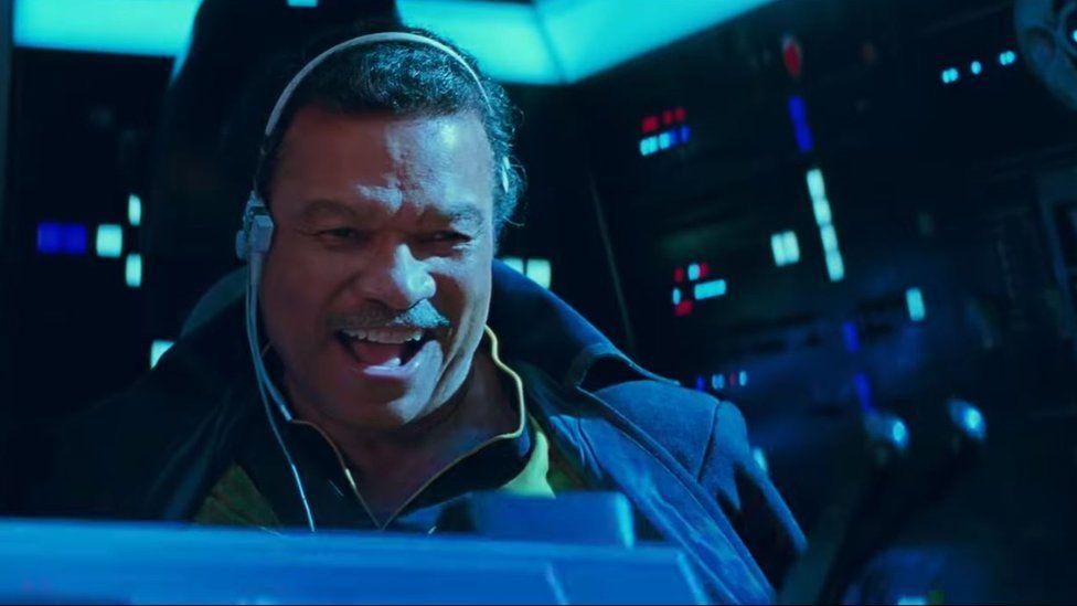 Lando Calrissian piloting the Millennium Falcon