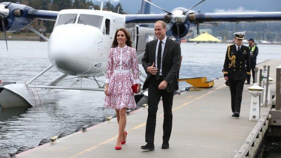 Duke and Duchess of Cambridge getting off sea plane