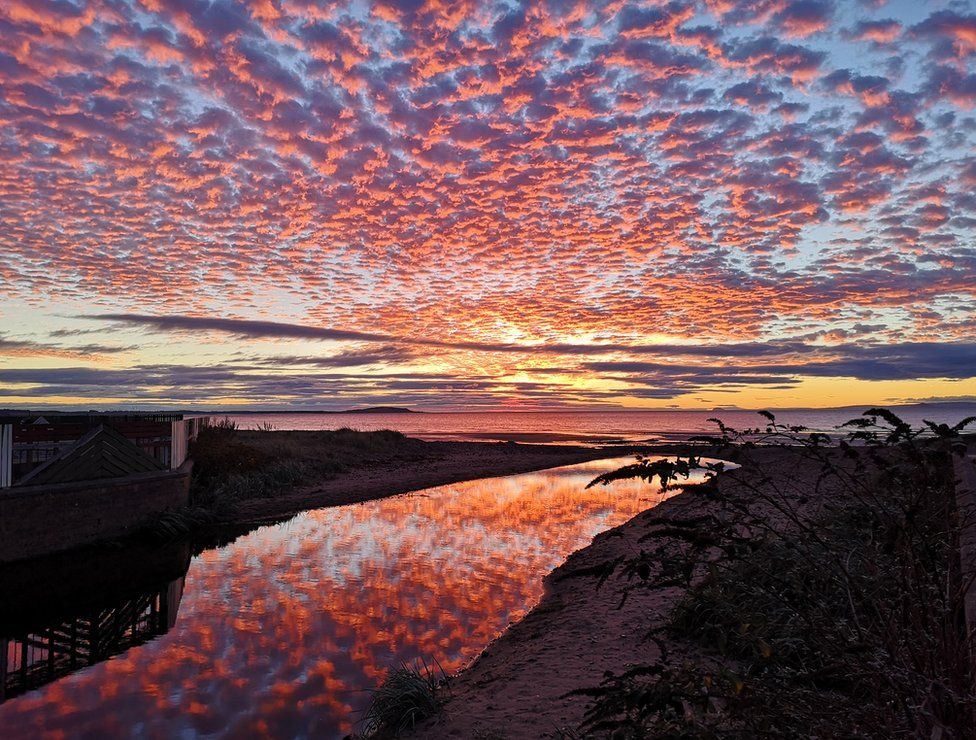 Sunrise with reflection at Leven beach in Fife