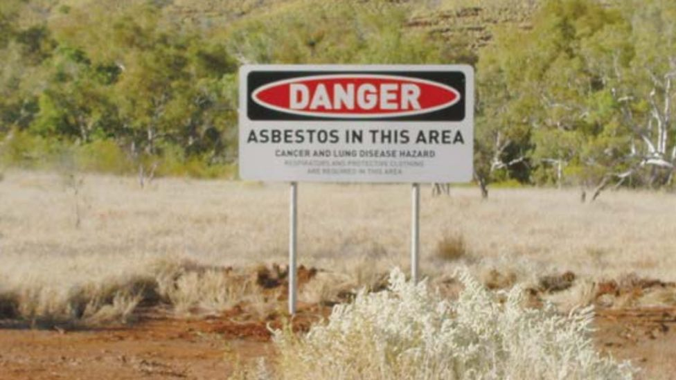 A warning sign around Wittenoom which reads: Danger. Asbestos in this area. Cancer and Lung disease hazard