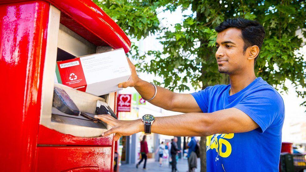 Man using parcel postbox