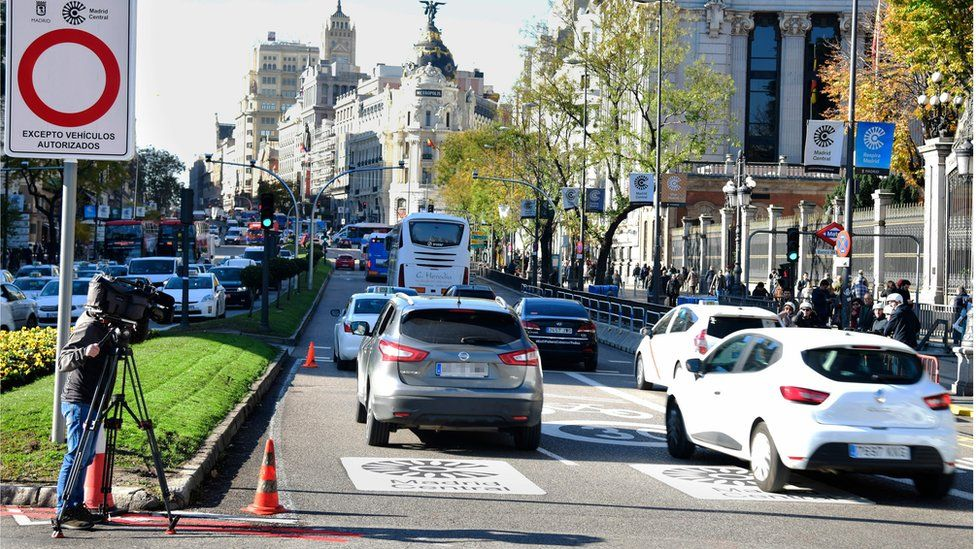 "Cars pass signs reading ""Madrid Central"" in the Spanish capital, 30 November 2018"