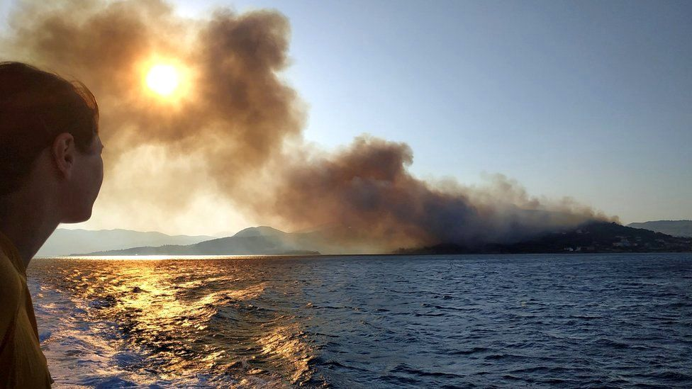 Smoke billows over the sea from a wildfire on Samos island, Greece, 24 August 2019