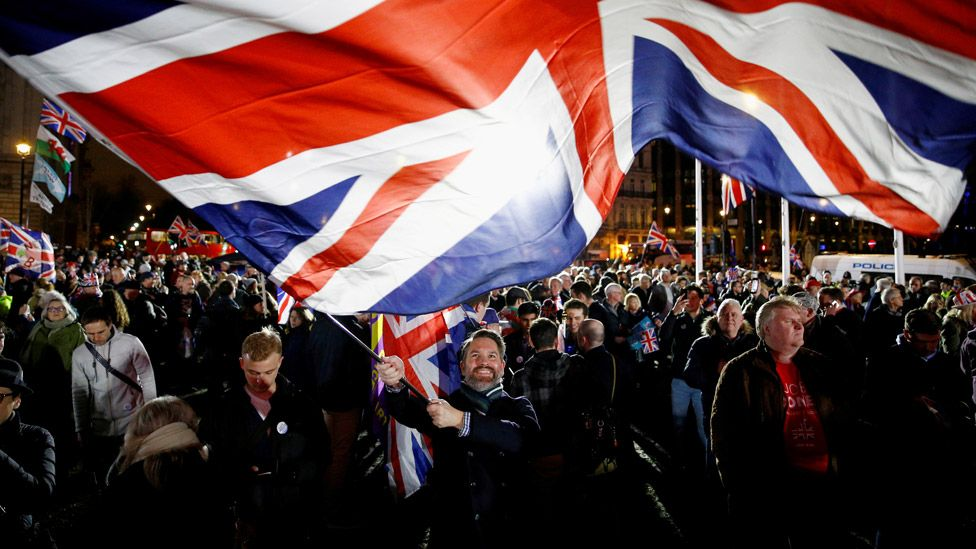 Man waving Union Jack on 31 January 2020, the day the UK left the EU
