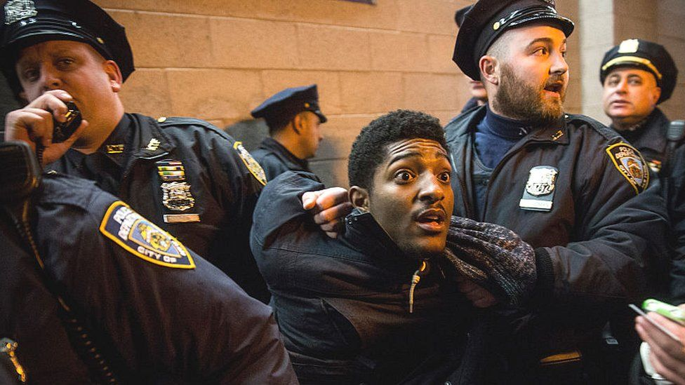 Protestor in Brooklyn being restrained by NYPD