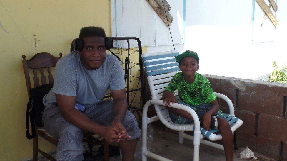 Jamieson George and son Kelijah, 10, seeking refuge at a neighbour's home