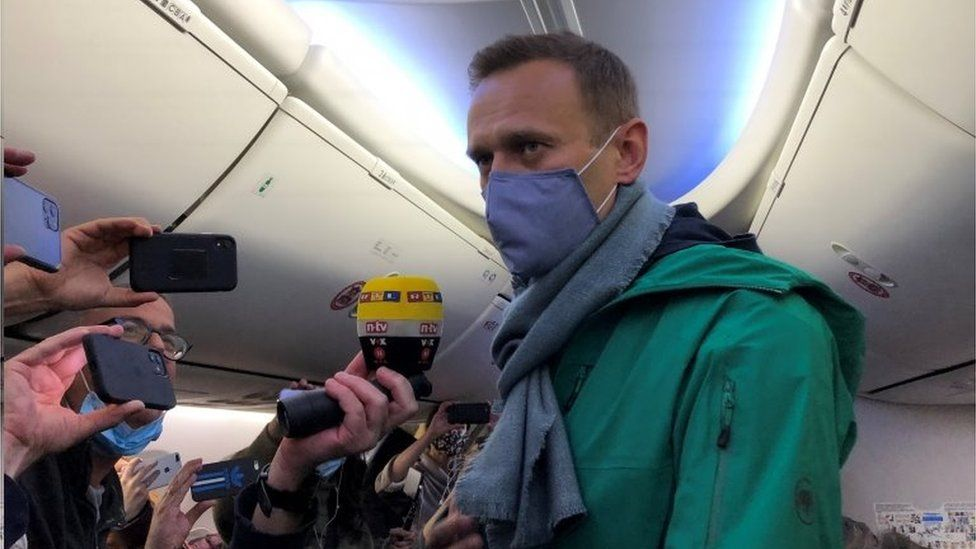 Navalny held after returning home to Russia